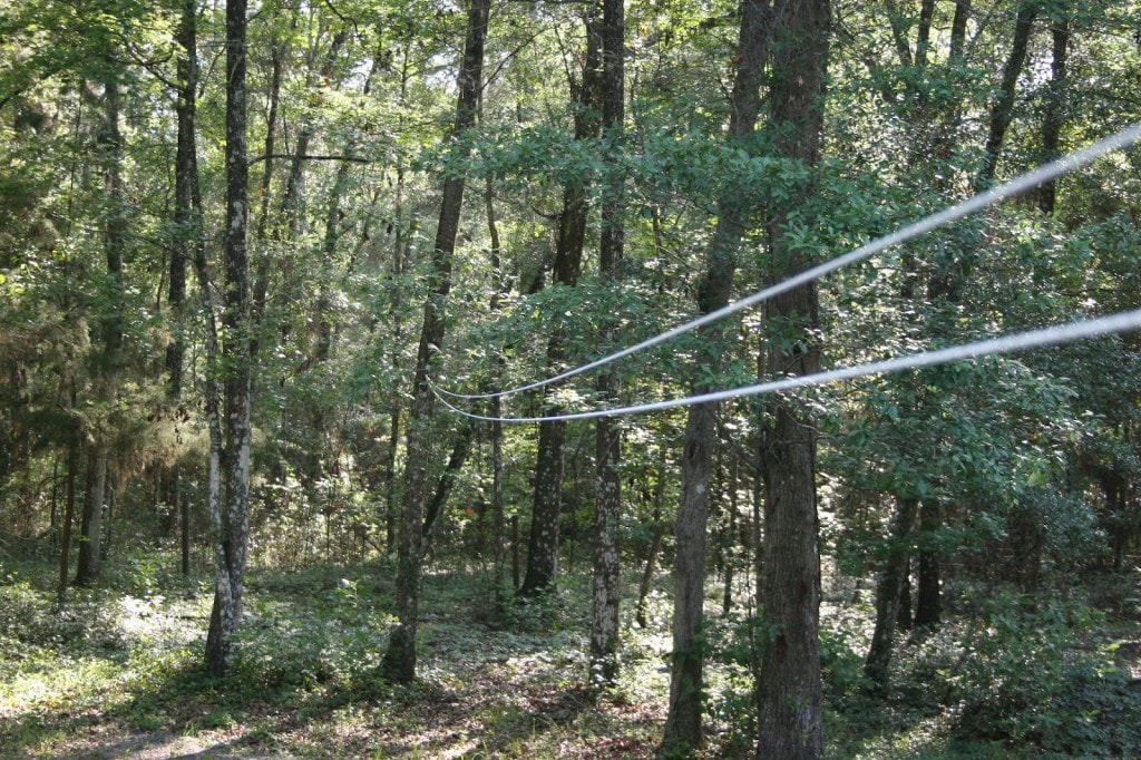 One end of the pulley clothesline should be anchored higher than the start of the clothesline, so clothes don't drag the ground.