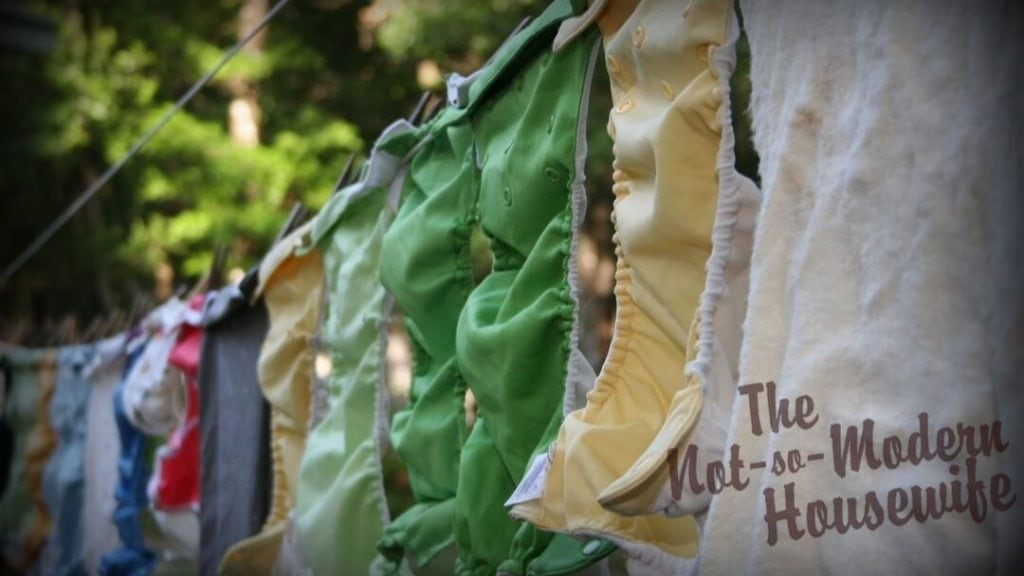 Laundry is hung on the clothesline with clothespins. The fabric can be overlapped to fit more laundry on the line.