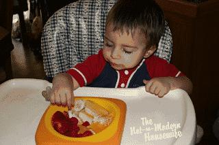 toddler eating fruit