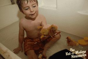 Farmboy holding duckling