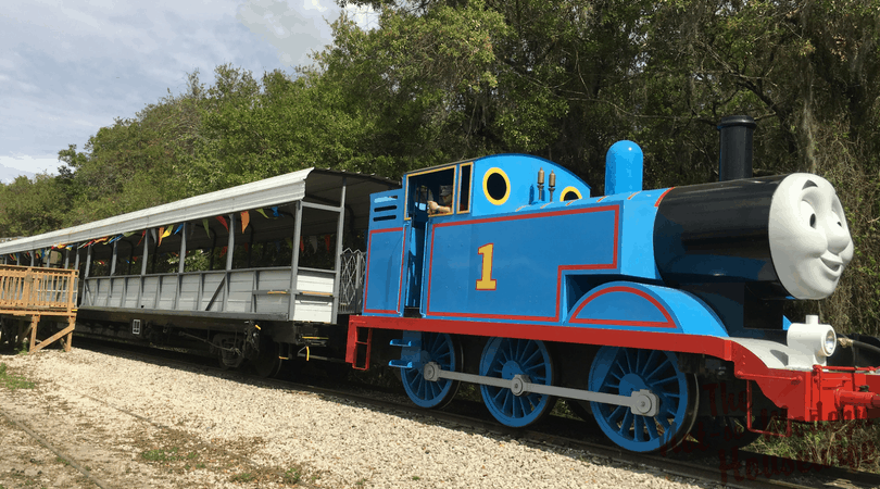 Thomas the Train pulling an open air passenger car at the Florida Rail Road Museum for Day Our with Thomas