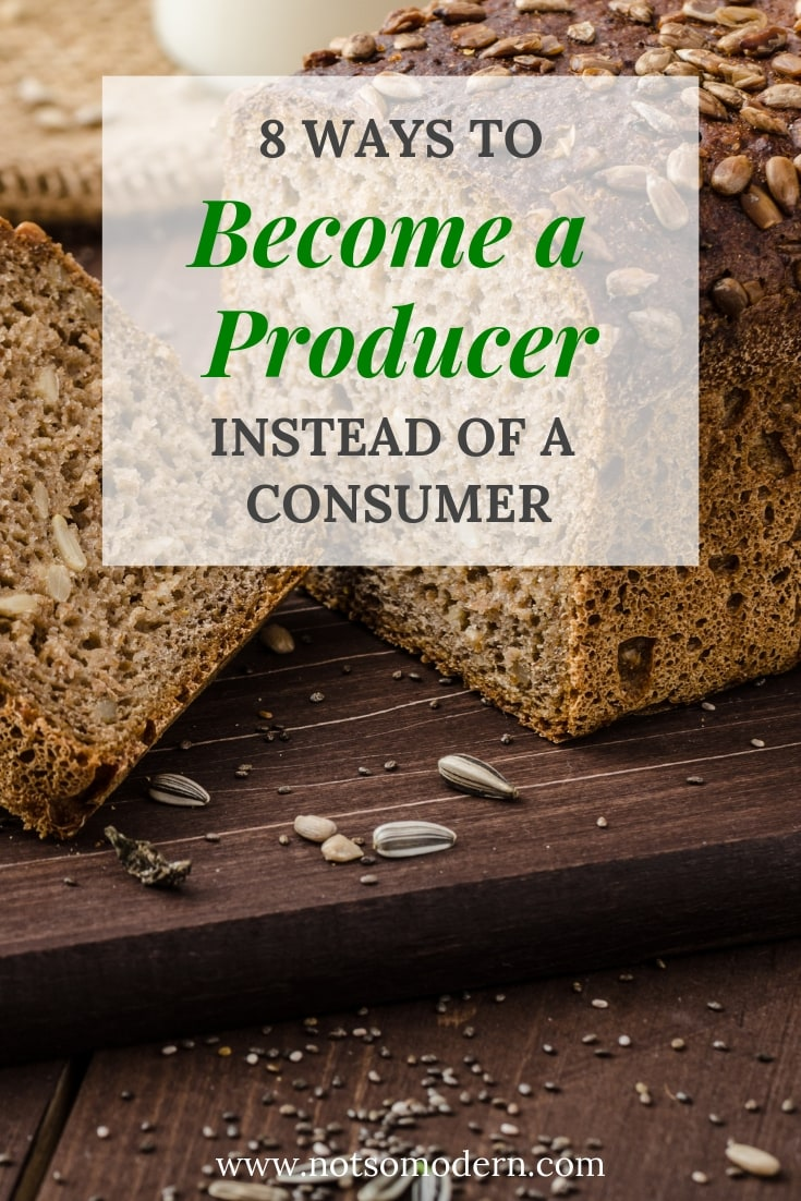 Homemade whole wheat sunflower seed bread on a wood cutting board - 8 Ways to Become a Producer Instead of a Consumer