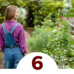 woman standing in greenhouse garden - 6 Reasons to Become Self-Sufficient