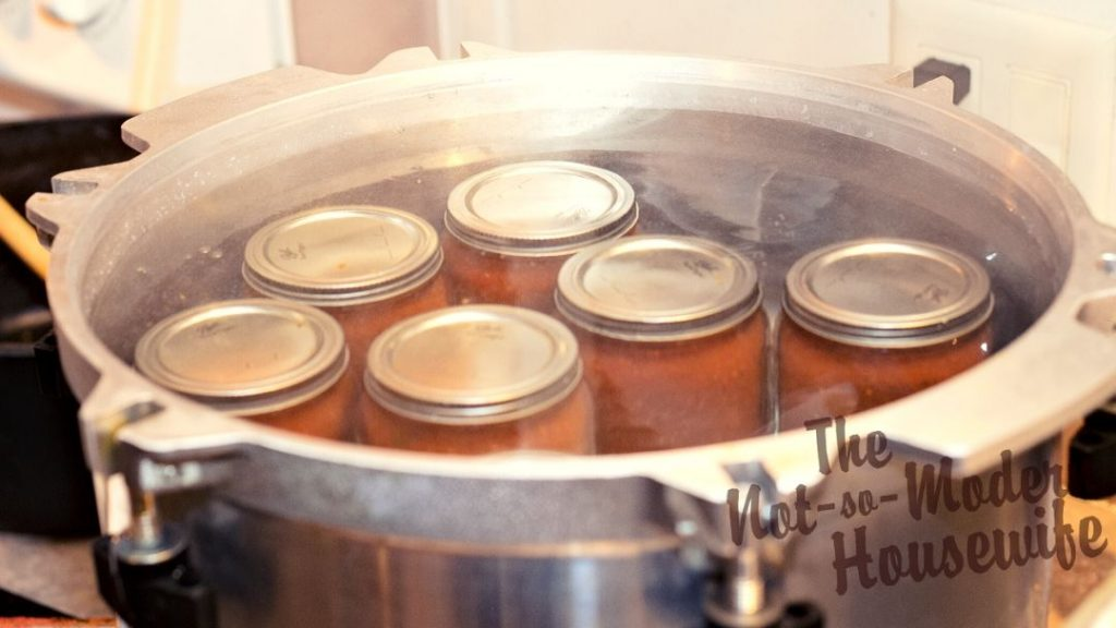 "Large pressure canners can also be used for water bath canning. When the canner is loaded with jars, you should make sure all jars are covered with 1-2"" of boiling water. If hot water must be added, do not pour the water directly onto the lids of the jars. Bring the water back to a rolling boil and place a lid on the canner before starting the timer for processing."
