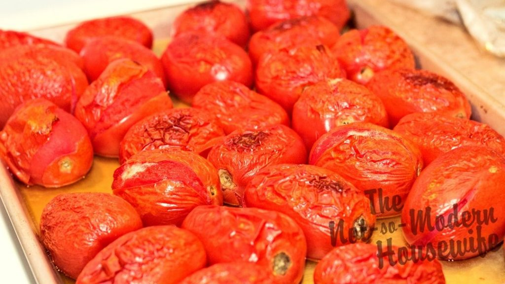 The skins on roasted tomatoes split while they are in the oven, making them easy to remove when the tomatoes are added to an ice water bath.