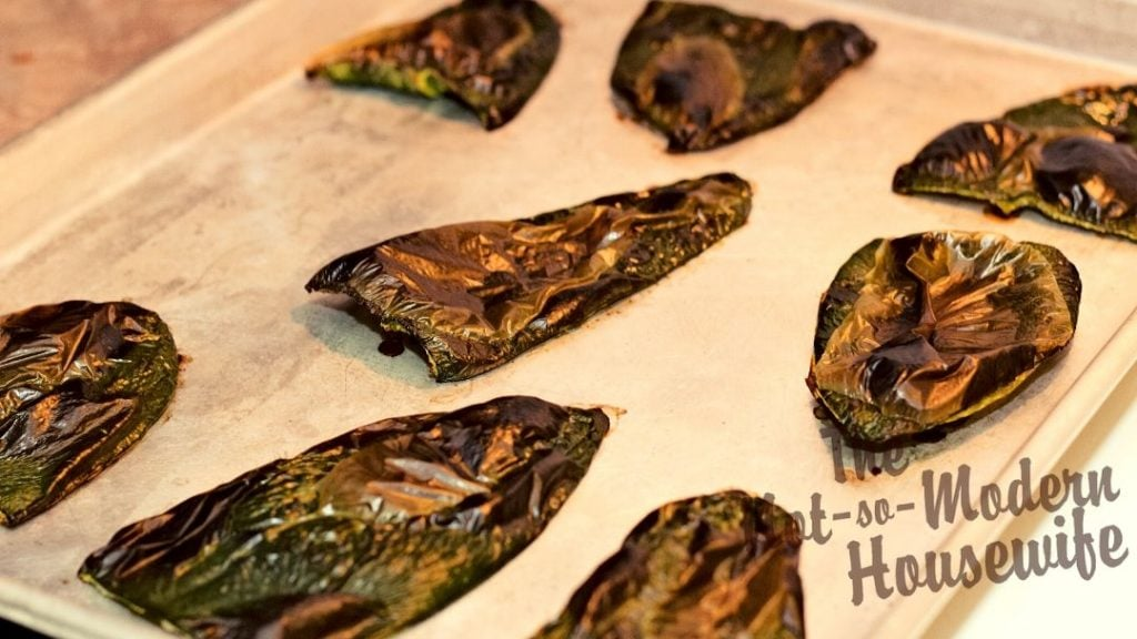 Poblano peppers have thick skins that will need to be removed before they can be diced and added to salsa. Roasting the peppers in the oven for 20 minutes will char the skins and make them easier to remove after the peppers sweat in an airtight container.